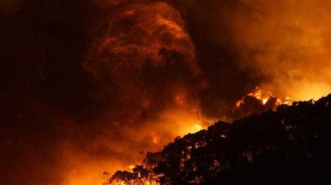 A supplied image obtained, Saturday, Dec. 26, 2015 of a bushfire at Wye River near Lorne south of in Melbourne. Fires yesterday destroyed 53 houses in the Otway Ranges.