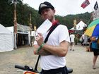 Scott Sneddon, aka Rodger the Postie, delivers letters at the Woodford Folk Festival. Photo Seanna Cronin / APN