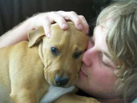 Tewantin man Nathan Wiseman, 21, also known as Nathan Thorn, hugs his pet dog Lenny.