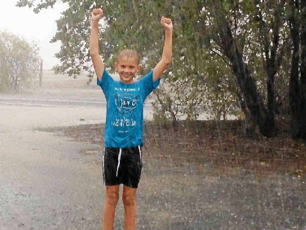 """YOU BEAUTY: Blake Siller, 12, is celebrating after 74mm fell at """"Monkana"""", south-east of Capella."""