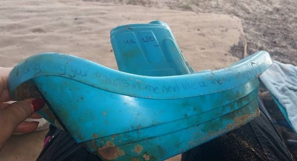 Toy tugboat washes up at Lillies Beach after two years on the water.