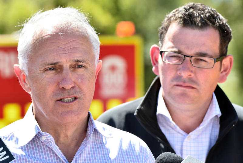 Prime Minister Malcolm Turnbull (left) and Victorian Premier Daniel Andrews address the media in Wye River on Tuesday, December 29, 2015. The coastal town was razed by bushfires on Christmas Day.
