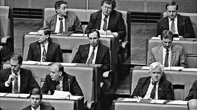 Treasurer John Kerin delivering his first Budget speech, August 1991. Paul Keating, who had recently resigned as Treasurer following an unsuccessful leadership challenge to Prime Minister Bob Hawke, can be seen on the backbench. Photo National Archives of Australia