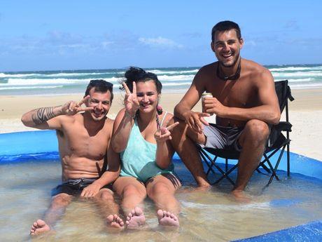 Enjoying a dip in a wading pool on Teewah Beach are (from left) Matty Rush, Vanessa Gaskin and Jack Arnold. Photo Stuart Cumming/ Sunshine Coast Daily