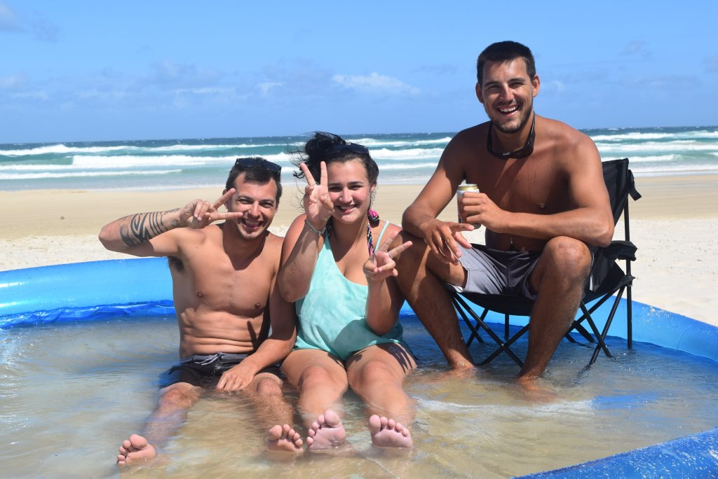 Enjoying a dip in a wading pool on Teewah Beach are (from left) Matty Rush, Vanessa Gaskin and Jack Arnold. Photo Stuart Cumming/ Sunshine Coast Daily