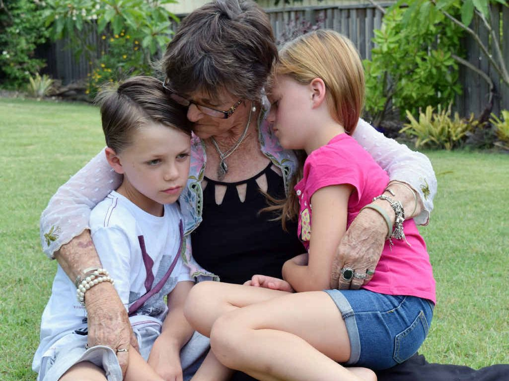 FAMILY TRAGEDY: Motorbike rider David Bailey's family (from left) son Jacob, 8, mum Ann and daughter Adelaide, 7, are still coming to terms with his sudden death on Boxing Day. BELOW: A Lego tribute Jacob made for his dad.