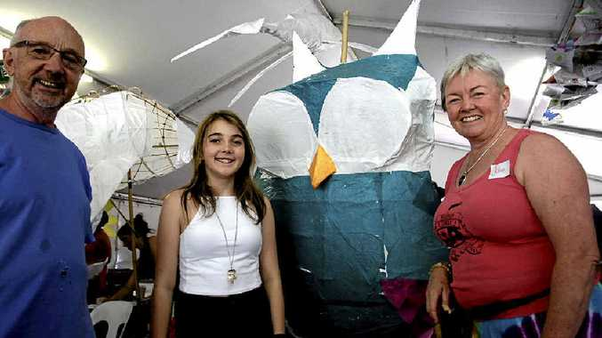 James and Alex Lownie with lantern parade organiser Julie Martyn and their owl creation.
