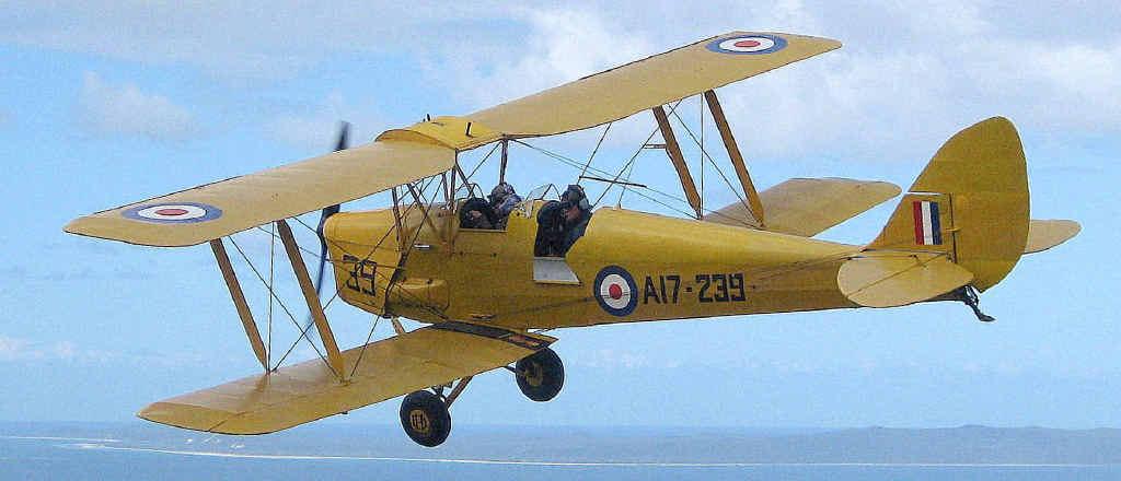 FLYING HIGH: Pilot Nick Maylor takes his beloved Tiger Moth on a joy flight over Moreton Bay.