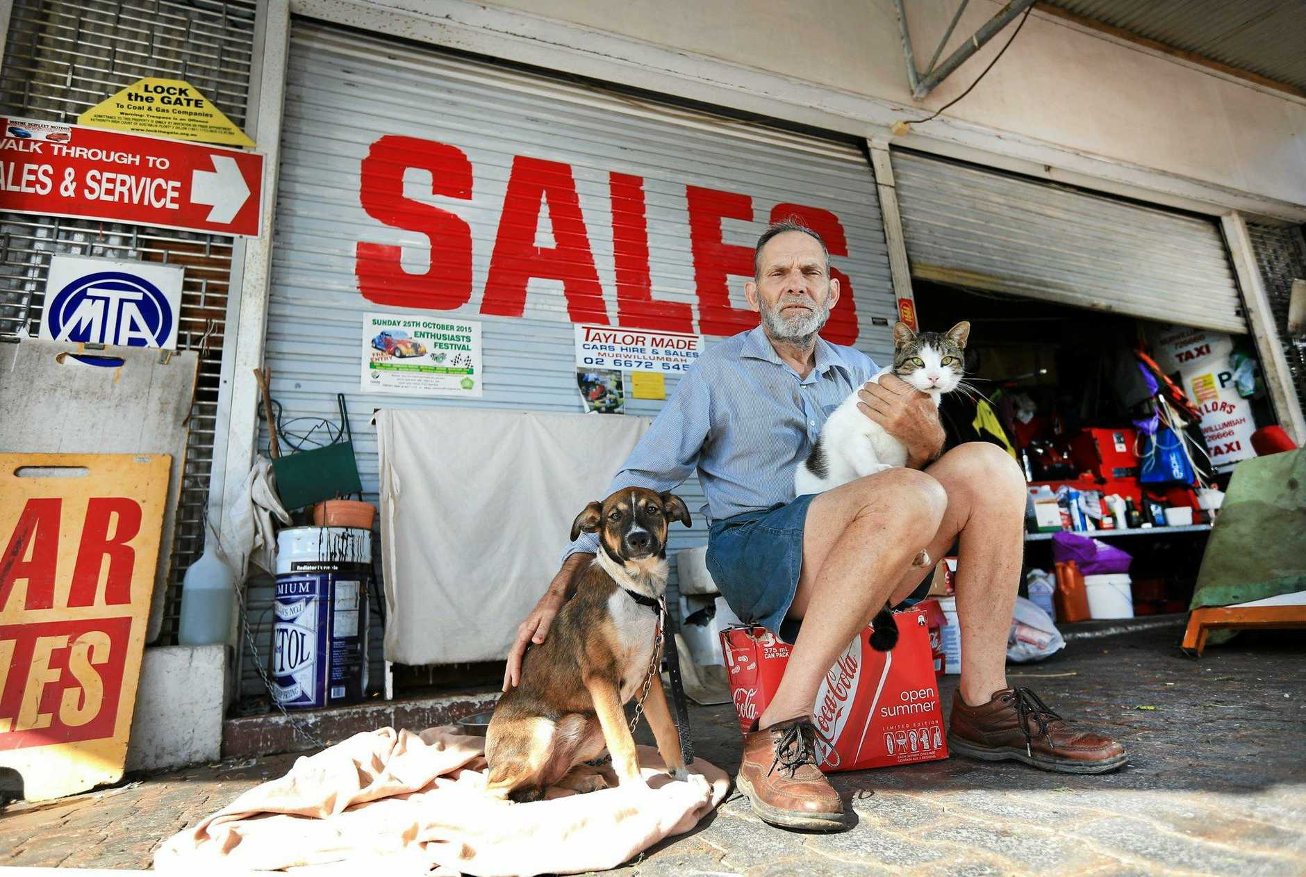 Phil Taylor with his cat and dog who are retiring with him to Kyogle. Photo: Scott Powick Daily News
