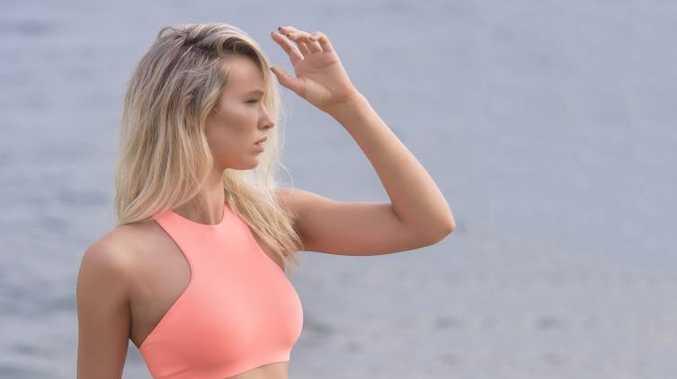 Model Karla Bodycote shows off her swimwear style on Whiting Beach in Yamba.