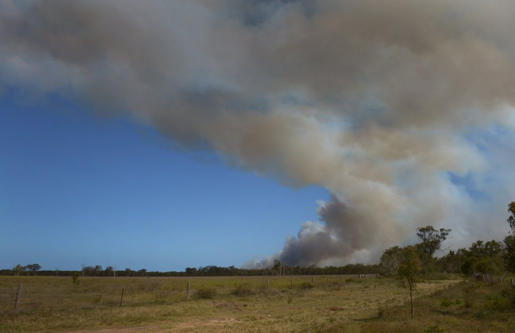 SMOKE CLOUD: A large bushfire in the Burrum Coast National Park. Photo: Mike Knott / NewsMail