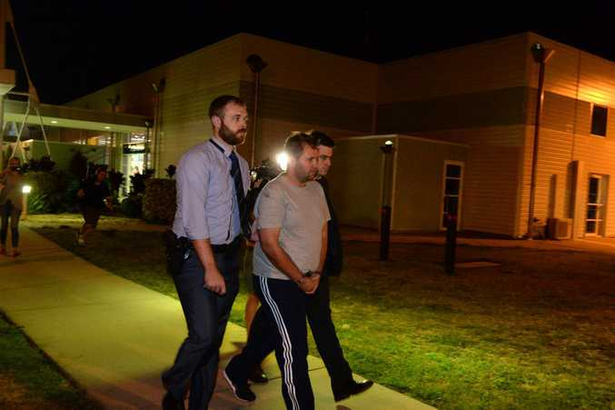 Jason Wayne Greatbatch, now 36, from South Australia, arrives at Mackay airport with detectives. He is facing charges including attempted murder for an attack on Teagan Moore at Kuttabul.