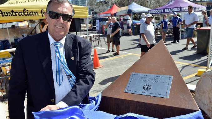 PRESERVING HISTORY: Maroochydore Surf Life Saving Club president Steve Weiland unveils the time capsule as part of the club's 100th anniversary.