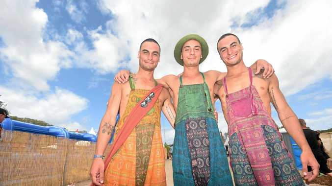 BROTHERS IN ARMS: Dean, Dylan and Daniel Bosilkovski, of Sydney, decided it would be great to hit the festival in the same outfit.