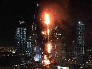 Massive fire rips through 40 storeys of skyscraper on NYE