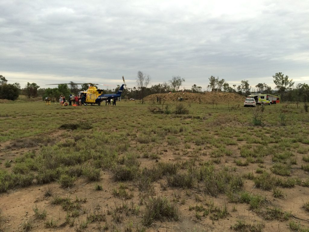 RACQ CQ Rescue landed near the motocross track in Tieri to airlift two patients to Mackay Base Hospital yesterday after a serious head-on collision. Photo RACQ-CQ Rescue