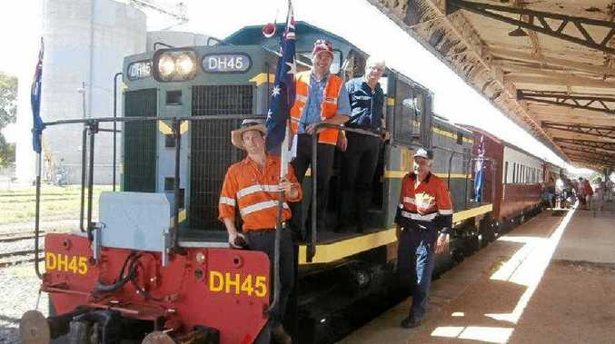 ALL ABOARD: Southern Downs Steam Railway volunteers Nick Geraghty, Adam Cole and John Davis with owner of the diesel locomotive, Adrian Hurley (middle) prepare for a new destination.