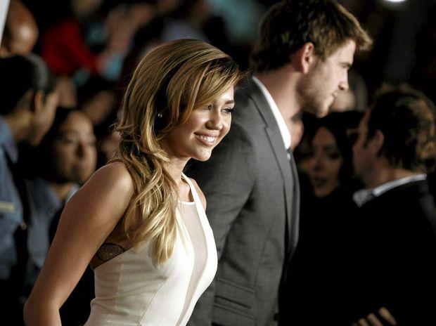 Miley Cyrus, left, and Liam Hemsworth were seen at Falls Festival 2015 together. (AP Photo/Matt Sayles)