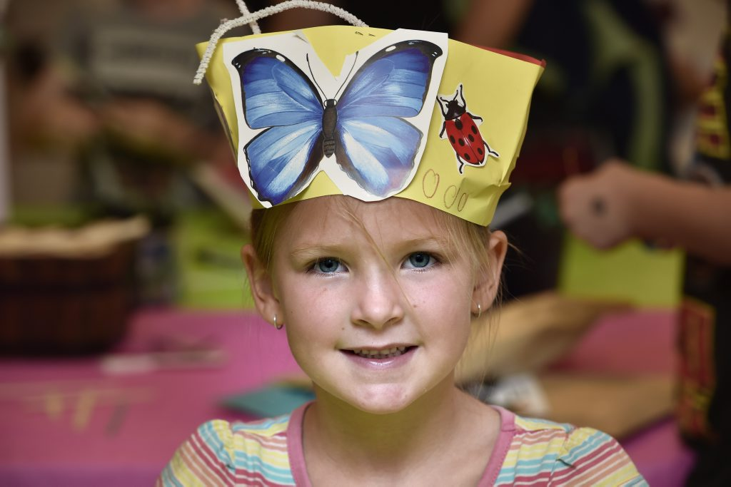 CRAFTY HAT: Isabella Schefe made a lovely hat during teh craft session at Bugs Alive at Cobb+co Museum.