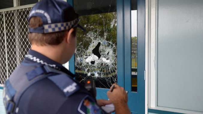 SCHOOL DAMAGE: Police investigate a break in at Central Bundaberg State School. Photo: Max Fleet / NewsMail