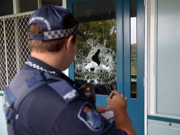 SCHOOL DAMAGE: Police investigate a break in at Central Bundaberg State School. Photo: Max Fleet / NewsMail
