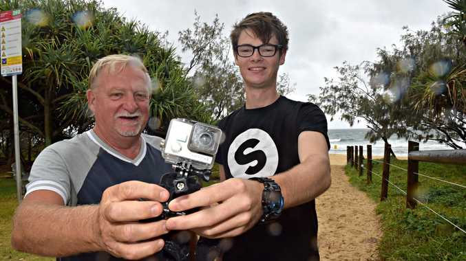 Bob Wurth returns the GoPro to a delighted Trent Smith.