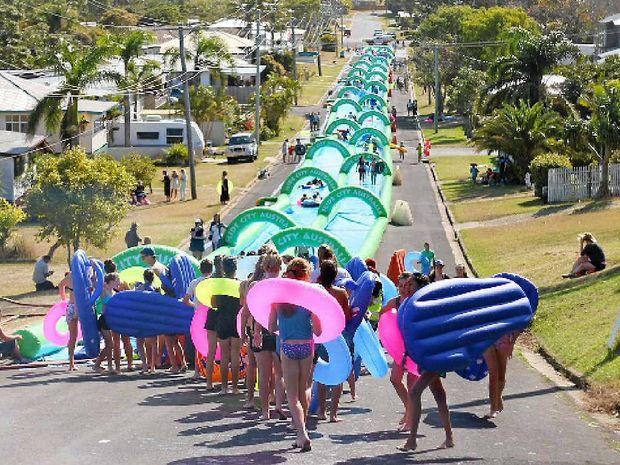 GET IN LINE: People line up in Yeppoon for O'Shea's City Slide Australia. INSET: PCYC President Greg Jones