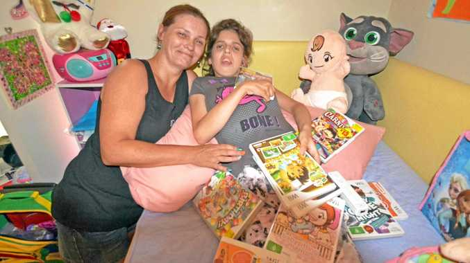 REASON TO SMILE: Angel Holdforth, 14, of Evans Head, who has arthrogryposis multiplex congenita, with her mother Leeanne. Angel has received a computer thanks to the kindness of six-year-old Coen Puglisi, of Swan Bay.