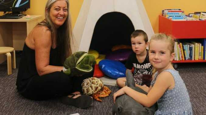 CHILD'S PLAY: Young people's librarian Karen Gawen plays with Charlie and Jax Mackenzie.