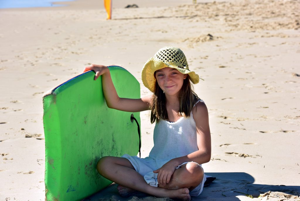 Summer Stevenson, 9, used her boogie board to rescue two children who got into difficulty swimming at Peregian Beach.