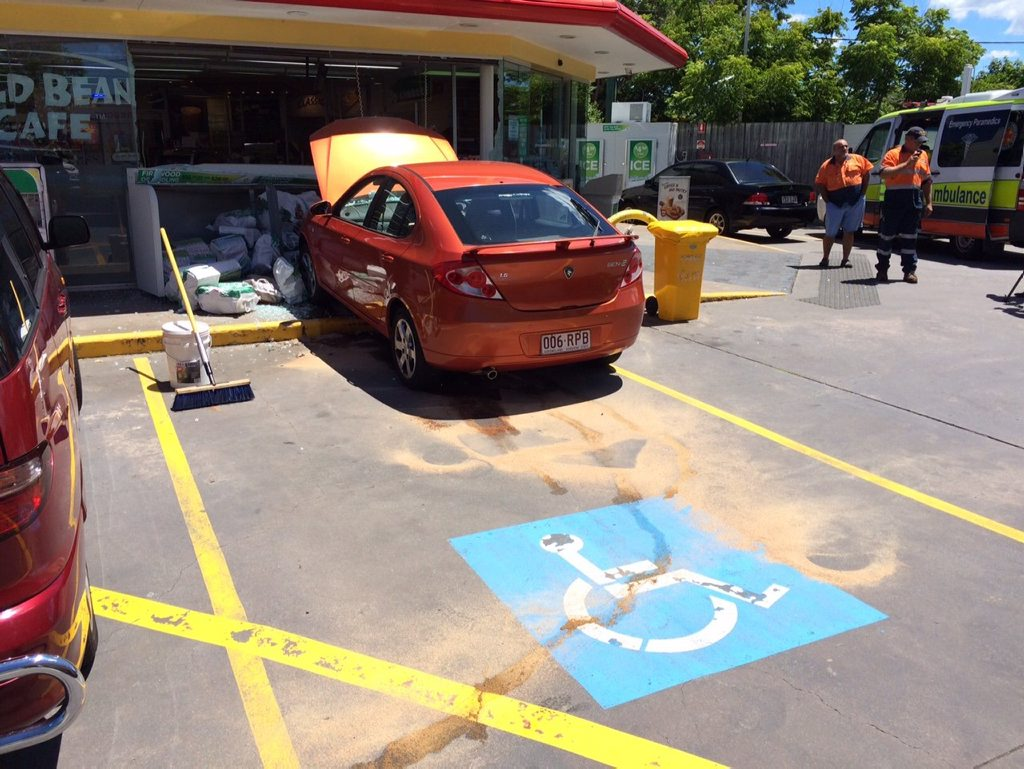 The vehicle collided with displays in front of the BP service station on Maroochydore Rd, smashing the shop windows. Photo Patrick Woods / Sunshine Coast Daily