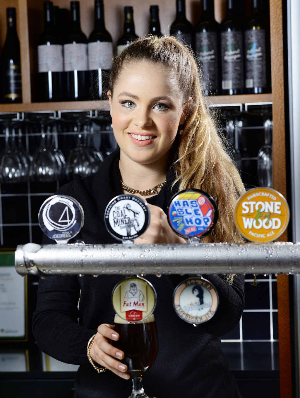 Chloe Johnston pulls one of the craft beers the Ulster Hotel has been famous for.