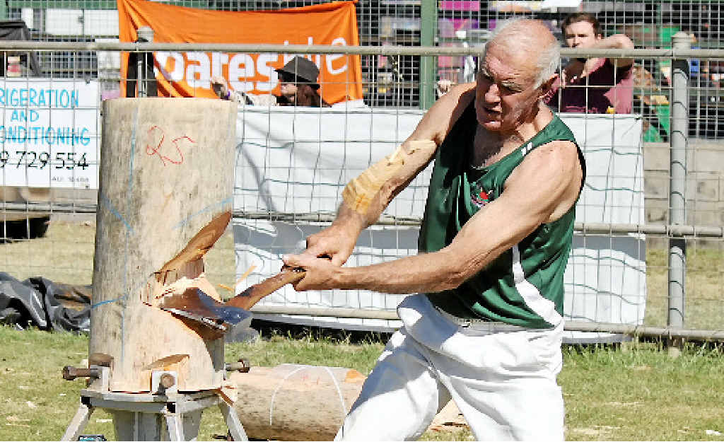IT'S SHOWTIME: George Quigg destroys his hoop pine block at the Emerald Show.