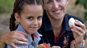 I'M NOT CHICKEN: Helen Doyle, 6, will be taking part in the Chicken Handler Award, pictured with Kirstie Henning from City Chicks.