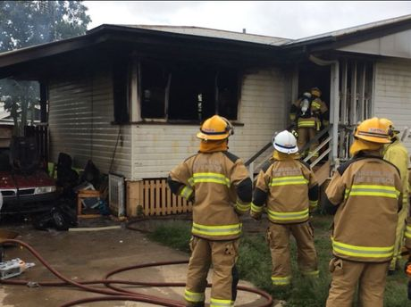 Firefighters battle a house fire in Dalby.
