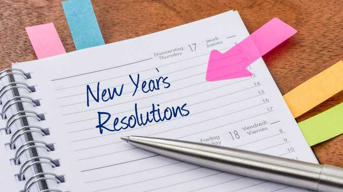 Daily planner with the entry New Years Resolutions.