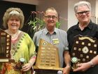 ALL SMILES: Elie Dean, Jeff Bloxsom and Terry Dean receive trophies at the Rockhampton Orchid Society's Christmas Party.