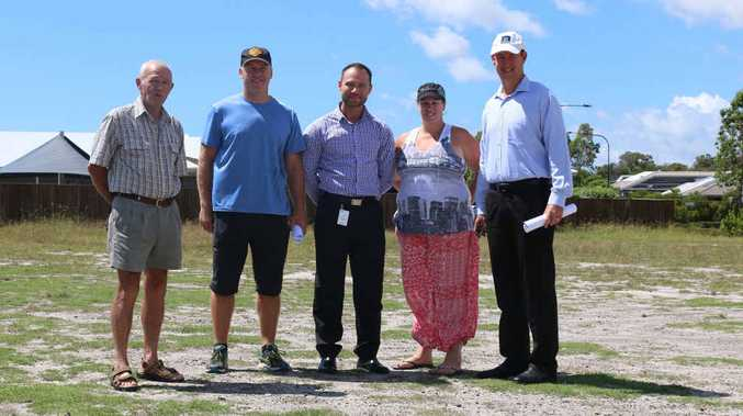 Brightwater Community Association president Neil Dougherty (left), Brightwater State School P&C; president Conor Walsh, Cr Christian Dickson, Brightwater Neighbourhood Watch co-ordinator Marni Brown and Stockland development manager Matthew Byrne at the community facility site at Brightwater yesterday.