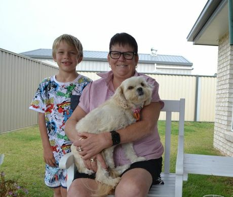 NOT DEFEATED: Kath Bushnell is treasuring every moment with her family and friends after being diagnosed with Motor Neuron Disease, including her grandson, Izaak Fulwood, and dog, Miranda. Photo Alana Calvert / Chinchilla News