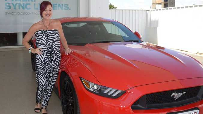 VERY EXCITED: Kylie Johnson takes delivery of her new Ford GT V8 Mustang from Coral Coast Ford. Photo: Mike Knott / NewsMail