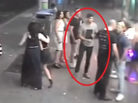 A man caught on CCTV footage appearing to throw a 'coward punch' at another man.