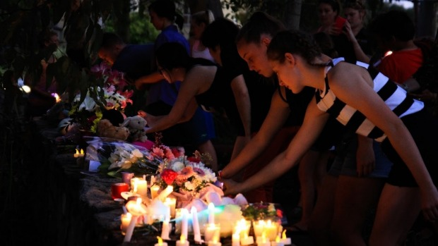 Community members attend a candlelight vigial for Queenie Xu. Photo: Jorge Branco