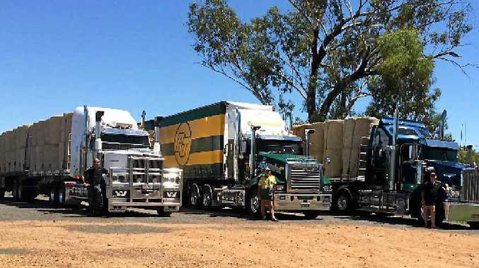 HAY ANGELS: The three Maryborough trucks and their drivers in Augathella on their way to drop off hay.