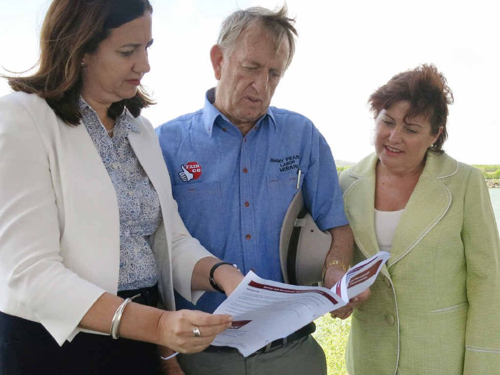 LOYAL: Mirani MP and former coal miner Jim Pearce (centre) has thrown his support behind Jo-Ann Miller (right).