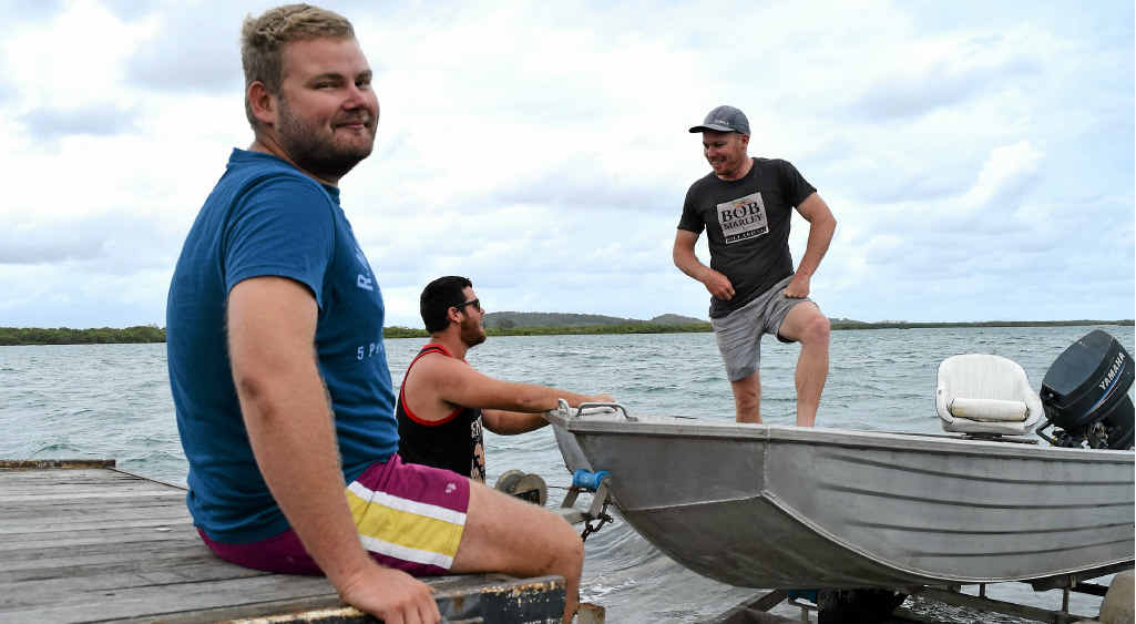 WATER TEST: Mates Isaac Colledge, Jacob Patterson and Jesse Moor reel in nothing but the tinny, to test the motor.