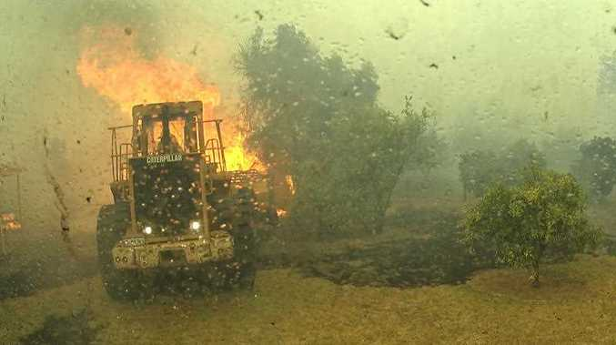 A supplied image obtained Sunday, Jan. 10, 2016 of video footage from a Parks and Wildlife truck in the Shires of Harvey and Waroona in Western Australia. Firefighters battle a bushfire that has destroyed 143 properties and killed two people.