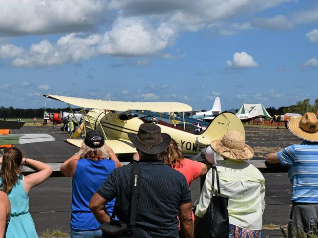 KEEN VIEWERS: Aviation enthusiasts watch the war birds get ready to taxi onto the runway at the 2016 Great Eastern Fly-In at the Evans Head Memorial Aerodrome.