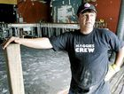 THEN: Hog's Breath Cafe co-owner Manuel Dimou only days after the 2011 flood stands in the gutted restaurant in front of the space where the bar used to be. Floodwaters rose to the roof of the restaurant.