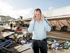 PHONE A FRIEND: Paul Pisasale worked two mobiles to ensure Ipswich was not forgotten through flood crisis.