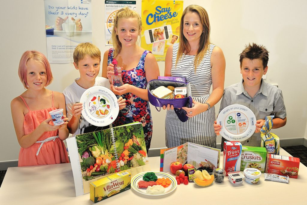 Gladstone GP Superclinic dietician Megan Leane recommends a balanced diet for the back to school lunchbox. Pictured with Tayla Sackley, 10, Ethan Sackley, 12, Kayla Sackley, 14, and TobyMarr, 10.